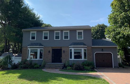 Beautiful Updated Center Hall Colonial with many updates; Gorgeous Tree-Lined Block of Charter Oaks; 4 Bed 2 1/2 Bath; NEW GAS HEATED Double Paver Driveway; NEW Windows, Siding, Roof; NEW OWNED SOLAR PANEL SYSTEM; HW Floors; Sewers; Underground Electric; Saltwater Pool w/ 3 Yr old liner; Flat Yard; Close To Shopping and Transportation. Move Right-In! Must See!
