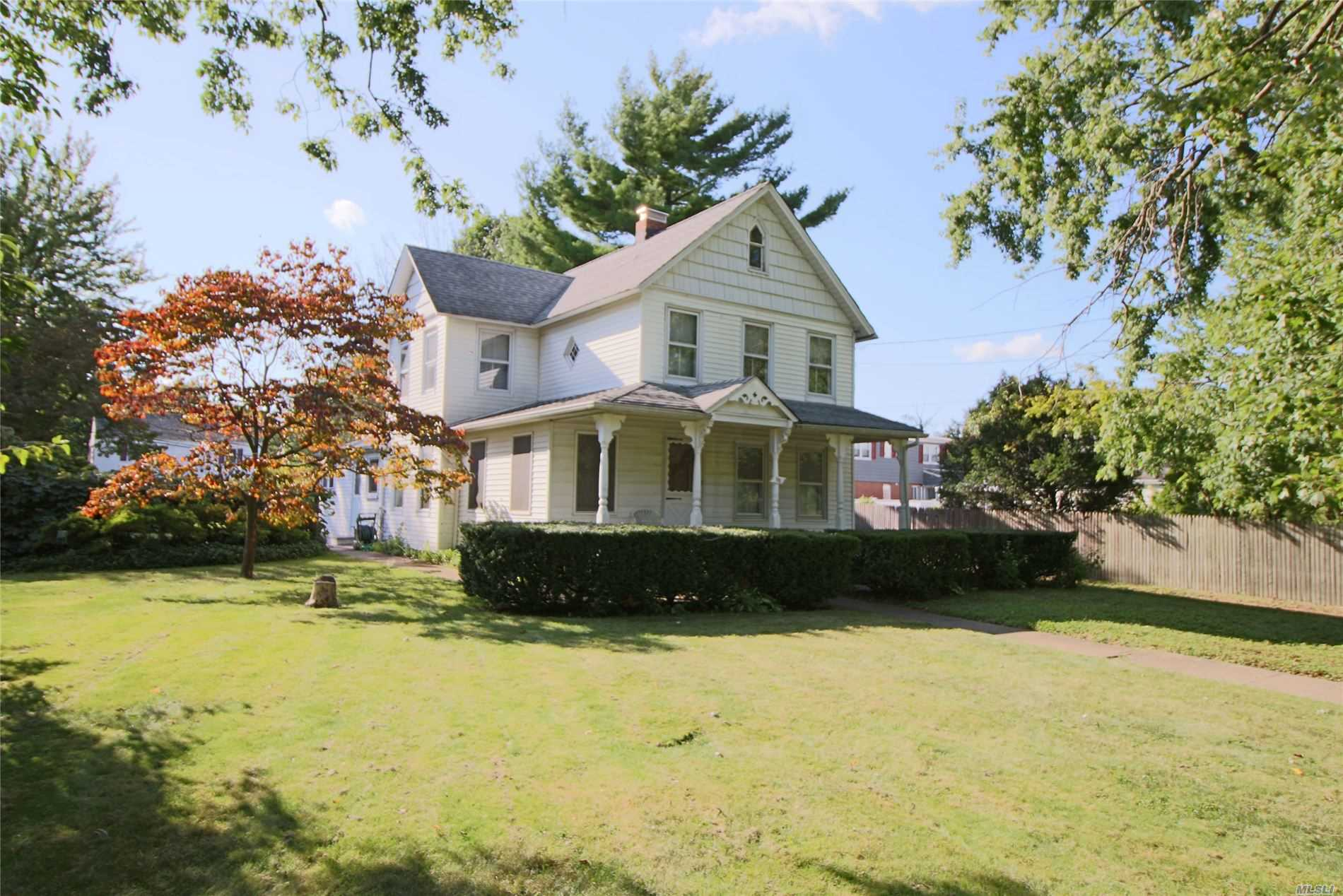 Property lover's dream (or can be subdivided). Feel like you are living in the country in this country chic home and only 30 minutes to NYC by LIRR!! Enjoy the fireplace in the formal dining room on cold winter nights!! Property with pond, runs from Ocean Avenue through to Doris Place!! LOW TAXES make this unique property a must see! A lot of history in this historic Victorian owned by one family since 1895!!