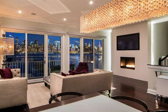 Take in the spectacular unobstructed view of the NYC skyline from every window in this home! This rare corner/end unit home sits in one of the most desired units along the Gold Coast. Sprawling across approx 2800 sqft, this 4Bed/ 3FB/2HBA home features luxury at every turn with custom lighting, crown molding, a gas fireplace, surround sound, high end security system, central vac, radiant heat floors and SO MUCH MORE. With a perfect floor plan for daily living and entertaining, this home will not disappoint!  The gourmet kitchen boasts stainless steel appliances, Calcutta marble counters and custom cabinetry.  Enjoy the large living area featuring an over-sized terrace facing the city, allowing for the most captivating ambiance. All of the bedrooms are very spacious and have ample closet space. This Community, which features 2 pools and a playground, is located close to shopping and transportation to NYC. 2 car garage and a driveway for a 3rd car. DO NOT MISS OUT on this very special home!