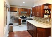 ***TOTAL 2063 Living SqFt** REMODELED FROM A TO Z. FAMOUS DEVELOPER FEW YEARS AGO.*** OPEN SPACE, WALL SPLIT SYSTEM UNITS, WOOD BURNING FIRE PLACE, NEW (HARDWOOD RED OAK, WINDOWS Double SHADE, NEW ROOF, NEW DOUBLE SIDING, NEW GAS FURNACE AND BOILER) SUNNY PRIME LOCATION. WALKING DISTANCE TO E & F SUBWAY, STEPS TO GRAND CENTRAL PKWY *2 BLOCKS TO HOUSES OF WORSHIP* MOVE RIGHT IN.