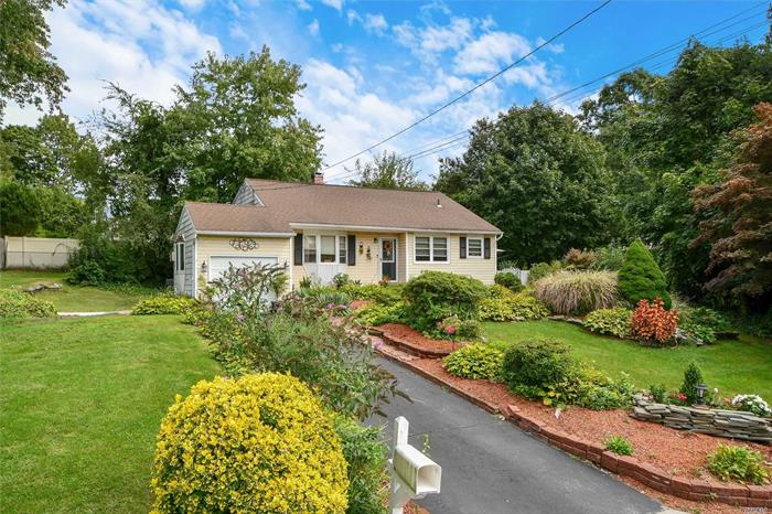 Split style home featuring large dining room with vaulted ceiling, living room with skylight, Eat-in-Kitchen, hardwood floors. This home sits on .33 acres and features 3 br, 2 full baths. Beautifully maintained corner property with private fenced in patio.