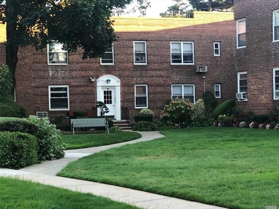 Newly Renovated Apt with Hardwood Floors, Beautiful Kitchen & Bath. Move in Condition. 1 Car Parking in Underground Garage. Street Parking Available. Laundry Room on Premise. Close to Shopping & LIRR. Must See it to Believe it!