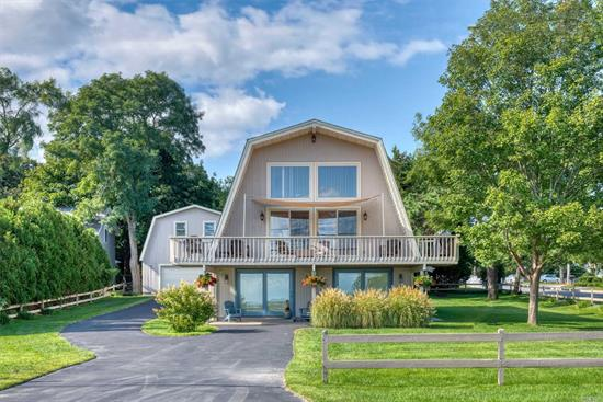 Why not have your home situated directly across the Peconic Bay plus beach right at your fingertips. Here's the ultimate vacation home with everything you've dreamed of. Lots of living space for entertaining. Plus you can put in a large in-ground salt water pool and then stroll to the beach to soak up more sun. It doesn't get any better than what this house has to offer.