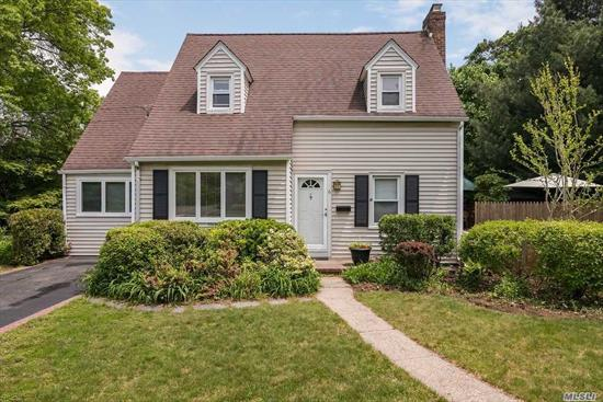Charming & Gracious. Updates: Windows, Roof, Siding, Gas Burner. Enter into Living Room w/wb Fireplace, Formal Dining Rm, Granite & SS Kitchen, 2 Family Spaces.( Den easily 4th bedroom ). Gardens, Decks, Porches. SD#29- MAMs, Calhoun, Convenient to Pkways, LIRR, Shopping.
