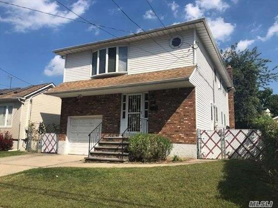 Large 5 Brs, 3.5 Bths, Custom Hi Ranch Home-Built in 1988. Full Finished Bsmt W/High Ceilings, Hardwood Floors Throughout, Vaulted Ceilings, Eik And Full Bath W/Skylights. Attached Garage W/Extra Storage Space And Vaulted Ceiling, Gas Heating 3 Zone, 2Brs On The 1st Fl, 3 Brs On The 2nd Fl. Fantastic Home For Extended Family. Possible M/D w/proper permits. Private Backyard, Great Location! Close To All!
