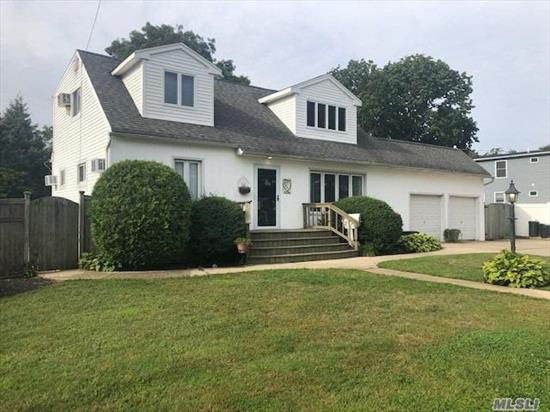 Big & Beautiful Expanded Cape with EIK, LR, Den/Office. Beautiful Wood Flooring Throughout. 4 Over Sized Bedrooms, 3 Baths, Full Basement Finished. Back Yard Paradise!!