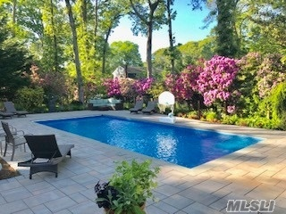 MARINA, DEEDED DOCK,  PRIVATE BEACH!! Gorgeous 4 bdrm, 2 1/2 bath colonial on wooded half-acre in Bay Woods, a private community,  2000 sq.ft. tri-level patio with pergola, saltwater pool, gas-fed fire pit and BBQ. Property has fenced yard, two-car garage, mature perennial garden and 7 zone sprinklers. Kitchen with Sub-Zero refrig. induction stove-top, Bosch dishwasher, large sit-at counter, butler pantry with sink & wine cooler. Family room & LR both with wood fireplaces. Half finished Bsm