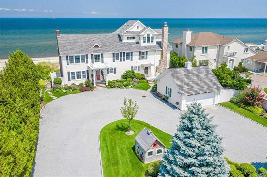 Beautifully Designed & Fully Renovated 4200 Sqft Waterfront Colonial W/100 Feet Of Beach Front. Magnificent Open & Airy Floor Plan w/Walls of Glass & Breathtaking Panoramic Views of LI Sound! Large Chef's Center Island Kitchen w/Fp & radiant heat, Two Possible Master Suites w/Private Balconies, All Ensuite Baths. An Amazing Entertainers Delight W/Expansive Trex Deck, Bar Area & Built in Grill. Steps Down To Private Beach. Double Gated Entry & Circular Drive.Gas Heat. Just Spectacular!