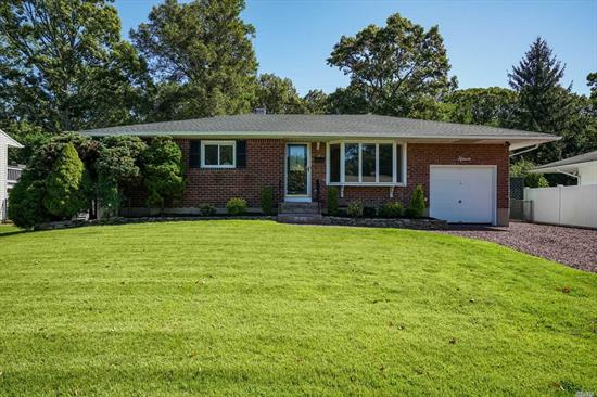 Nearly brand new home offers, new roof, kitchen, new hot water heater, polished wood floors, hi-hats, carpeting, updated baths, privacy, mid-block location, Commack Schools.