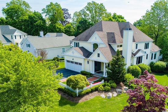 Handsome Colonial privately located on Gracewood Drive directly across from the Gracewood Mansion. Dramatic formal living room with soaring ceilings, open layout throughout, dining room, bright kitchen and great room with high ceilings. Master en suite conveniently located on first floor with ample closet space and laundry room. Three additional bedrooms with two full baths on 2nd floor along with a separate mezzanine loft sitting area. Finished walk out lower level, 2 car garage and generator.