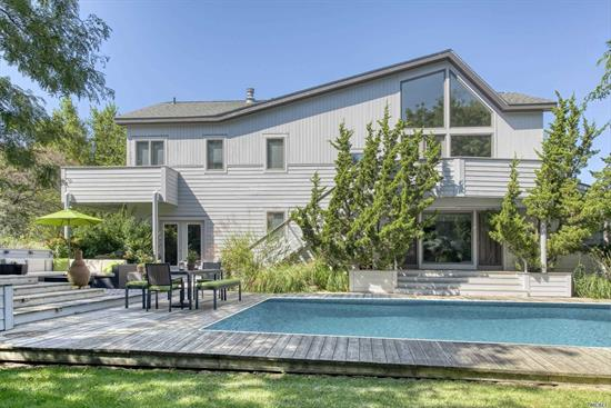Contemporary & chic, mint condition home in Eastern Shores, Greenport. Newly renovated with open light-filled floor plan, pool, hot tub, first floor sleeping, custom gourmet kitchen, hardwood Brazilian cherry floors, 2 second floor balconies, beautiful deeded association beach.