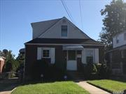 BRICK CAPE COD WITH SIDE DORMER FEATURING NEW EIK 4 BEDROOMS 2 FULL BATHS FINISHED BASEMENT DRIVEWAY PARKING