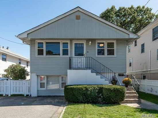Mint and newly renovated 3 bedroom/2 full bath with washer and dryer included. Open floor plan with EIK and quartz counter-tops, stainless steel appliances, hardwood flrs, lrg attic space for storage, use of fenced in backyard, extra storage.