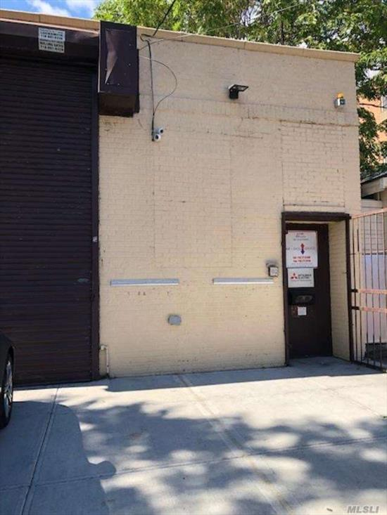 Free standing fireproof bldg in heart of Woodside - 10 min to NYC. 900 sf office. 1600 sf garage.Entrance way into reception area. 3 offices. 2 bath. Kitchen. Heated garage-14'ceilings.Tile flrs thruout. LED lighting. Central station alarm. 4 zone security cams. 200 amp.elec. 9 yr old insulated roof. 1 1/2 yr. old roll up door for garage. Stge. space above office. 2 blocks from BQE. 1 block fr. No.Blvd. Currently being used as HVAC company. will be vacant at closing.