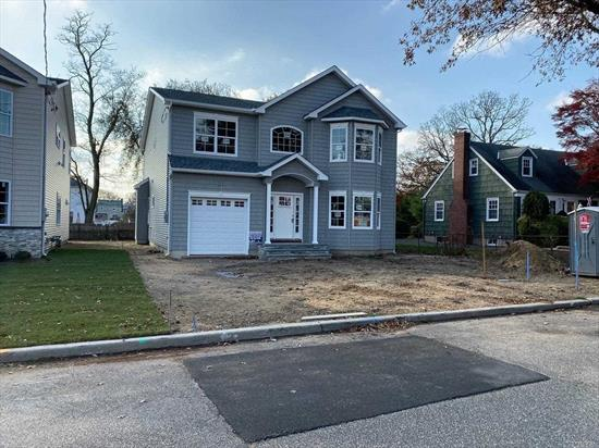 Brand New Construction Exquisite Colonial W/Architectural Details Throughout! Deep 125' Lots! 4 Bdrms/2.5Bths! Lg 2 Story Entry, Lvrm, Fdr, Fam Rm W/Fpl & Magnificent Eik W/Gran Isl, Gas Heat And Cooking*** Large Master Ste W/Lux Fbth, & 2 Lg Walk In Closet. Pristine Bellmore Loc Close To Schools/Lirr/Dining/Shops/Etc. No Amenities Spared!