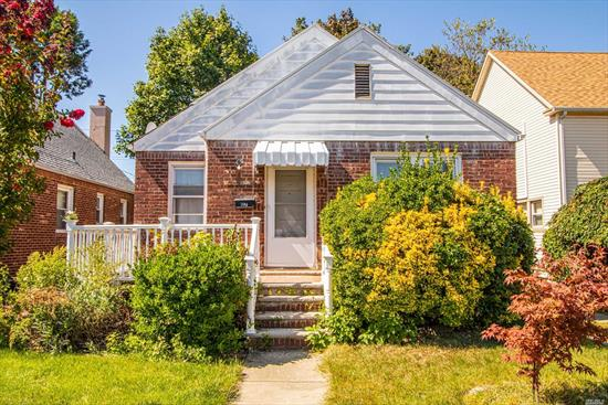 Welcome to 97 Heathcote Rd in Elmont this 2 Bedroom Brick Ranch has Gleaming Hardwood Floors, 2 Full Bathrooms,  Full Basement and a One Car Garage come take a look and make this your new home!!!