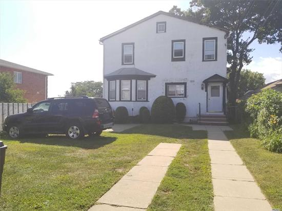 Very well maintained 2 family house features 3BR apt over 3BR apt, with separate entrance full basement, very private location, flag-shaped irregular lot, Front long driveway(14.75x85.97) leads to the property( 25--36 width x 81.50 depth) situated in the back of the lot, large front yard, near to all major highway, transportation, This is a great investment property!! 2 gas meters & 2 electricity meters,