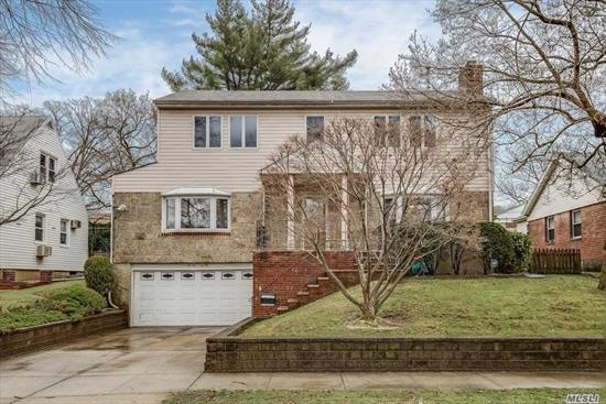 Large Colonial In The Heart Of Oakland Gardens In Mint Condition. Lot Size 60X100, Building Size 43X38. Total of 4 Beds, 3.5 Baths. One Bed Room and Bath On 1st Floor. Living Rm With Fireplace. New Hardwood Floor, Granite Kitchen Counter-Top. Anderson Windows, Updated Central AC System. Legalized Big Green House W Hot Tub & Fire Place. Two Zone Gas Heat and In-Ground Lawn Sprinklers. School Dist. 26, PS.46/MS.74. Easy Access to Major Hwy. Walk to Park, Library, Shops & Buses.