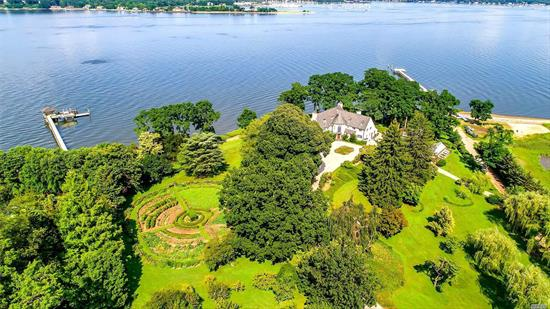 Normandy inspired Ch?teau North is a waterfront French Tudor in the prestigious village of Kings Point. Just shy of 8 acres of land, this home boasts an 'all-season' organic English Garden with a sitting rotunda, decorative box hedging, irrigation system, exotic florals and multiple species of fruits/vegetables. A gazebo stands at the edge of the peninsula with endless water views. Other features include a greenhouse, dock access, greenhouse, dock access and swimming pool bordering the water.