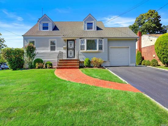 Wonderful Updated Cape Cod Home on the Quiet corner of Nevin Terrace with A Huge Backyard!!! A Secluded Patio Area plus Extensive Lawn & Gardens (See Attached Survey). 3 Zone Gas Heat & Gas Cooking, Water Heater, Dryer. Kitchen/Granite/Tile. HW Floors on the 1st AND 2nd Floors. Newer Bath/Walk in Shower. Tub in Upstairs Bath.        Bow Window & Plant Window! Roof, Siding & Windows approx 6 yrs Young. Multi Car Driveway. Simply A Pleasure!!!