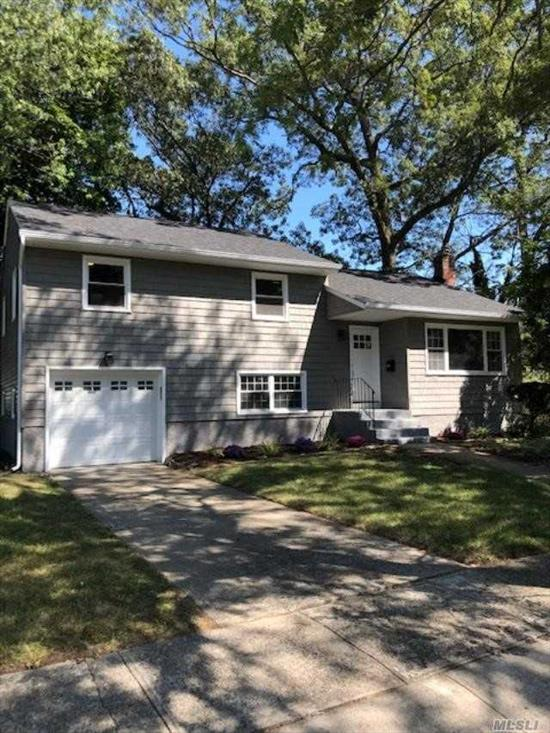 Beautiful Fully Renovated Large Split Level 4 Bedroom 3 Full Baths set on a Cul-De-Sac. MANY UPGRADES, includes New Windows, New Roof and Siding,  Wood Floors Throughout, Beautiful New Kitchen w/White Shaker Cabinets and Quartz Countertops, Kitchen Island, Samsung SS Appliances, Finish Basement, Large Yard,  Very Low Taxes. LOTS OF SPACE FOR A LARGE FAMILY. Located Half a Mile from Southern State Pkwy with Great Commute to Brooklyn.