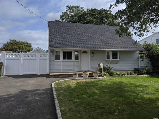 Diamond Cape Home. Home Features Update Eat In Kitchen With Stone Counter top, Large Bedrooms, and Hardwood Floors Throughout. Nice Backyard With Large Detached Garage. East Meadow Schools.