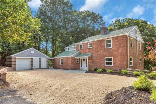 Beautifully renovated large colonial on 1 acre.