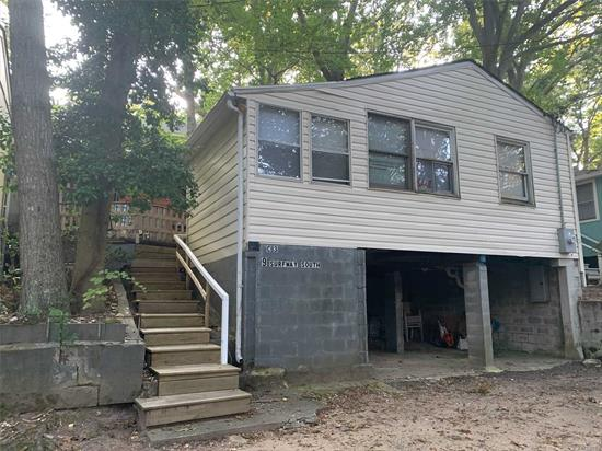NEW TO MARKET-GREAT POTENTIAL. Garage under neath a rare find. Open Floor Plan, Private back Deck & More. Walk to the Beach and enjoy all the North Shore has to offer or visit one of the many other local attractions like Splish Splash, Wineries, Atlantic Aquarium and more...