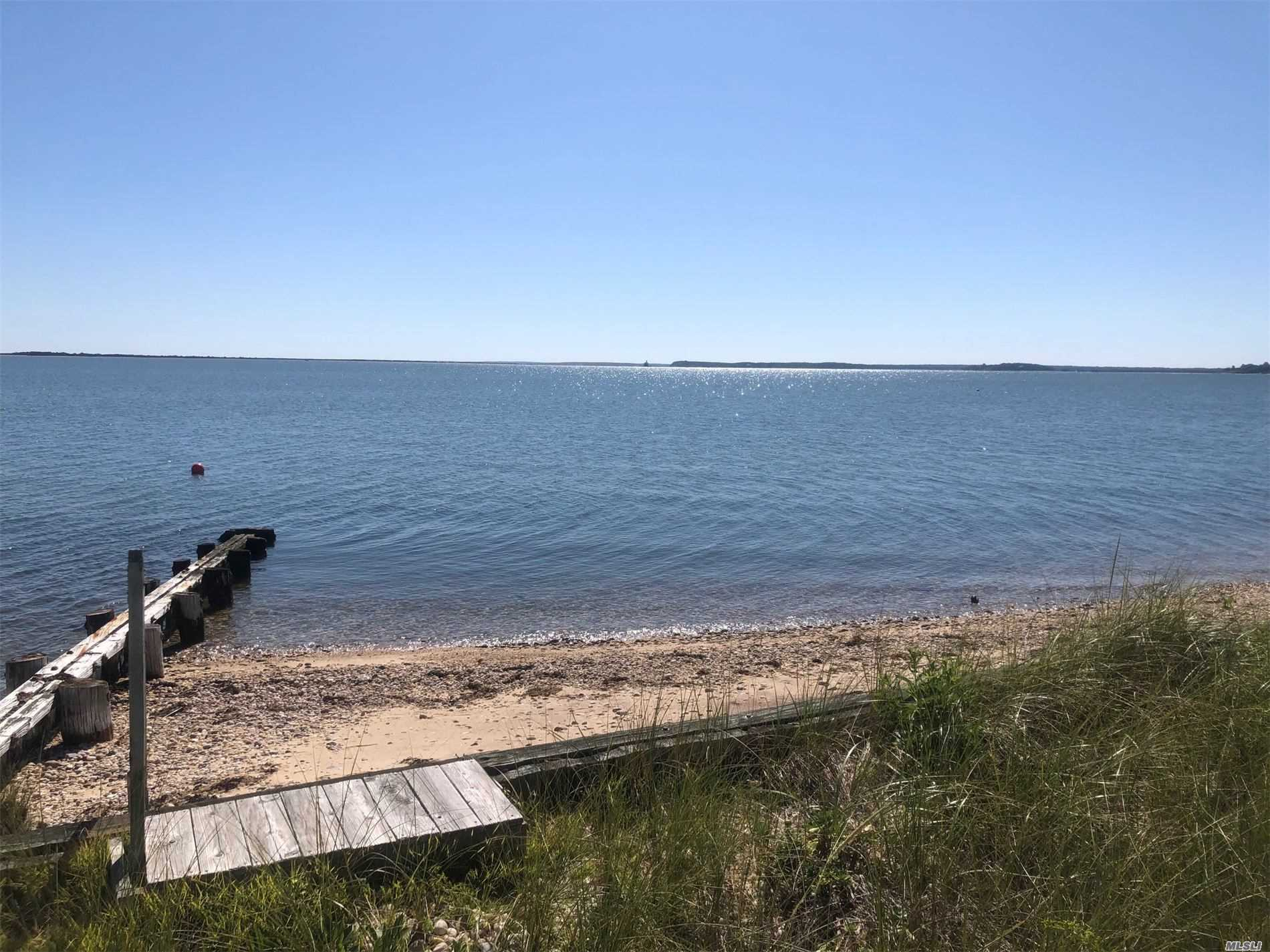 Location Location Location!! Gorgeous views of Bug Light, Orient State Park and much much more! This 3br 1.5ba house that is in need of TLC boasts 70 feet on Peconic Bay.