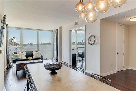 Best priced 2 bedroom 2 bathroom w/ unobstructed water and city views on the Weehawken waterfront! Located directly next to NY Waterway at Port Imperial, commute to midtown Manhattan in under 10 minutes! Routes to Pier 11 at Wall St. and World Financial Center available as well. Additional transportation options include Light Rail/Path or NJ Transit. Live luxuriously at the Avenue Collection with hotel-like amenities including a 24- hour doorman; concierge services & guest suites, state-of-the-art fitness center with sauna, steam shower, cardio and strength equipment, yoga room; outdoor plaza with convenience kitchen, open lawn, lounge areas, fire pit and sun deck; social room with catering kitchen, fireplace, bar area; grand lobby with wall-length fireplace; enclosed parking garage; security system; & conference room. In unit features include professional-grade GE Monogram appliances; custom cabinetry, granite counter tops, Brazilian chestnut floors, & private terrace. Whether Rising to the glorious sun or gazing at the metallic golden city at dusk, the views from residence 408 are sure to take your breath away. Call to schedule your appointment today.