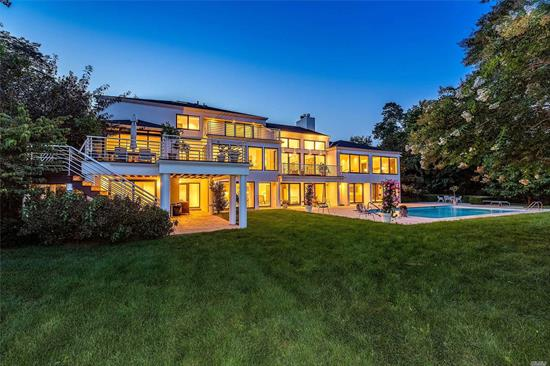 A rarely seen marriage of a luxury residence and expansive park-like grounds, complete with private access to the Long Island Sound. Architecturally stunning with floor to ceiling walls of glass overlooking the pool, tennis court, professionally landscaped grounds and launch point for your kayak or canoe.