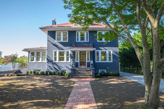 Stunning 3 story fully renovated waterfront colonial in the heart of Bay Shore historic Bay District. 5 bdrm, 3 full bth, 2 half bth, wd flrs, 2 fp's, 1st flr gst suite with private entrance, mstr bdrm w/fp & deck overlooking private canal. Spectacular kit design, brand new blkhd w/5 boat slips, 2 car gar, new driveway & lndscp, cabana/pool house. Walking distance to many of Bay shore Zagat rated restaurants and ferries to fabulous Fire Island! **Possible income potential**