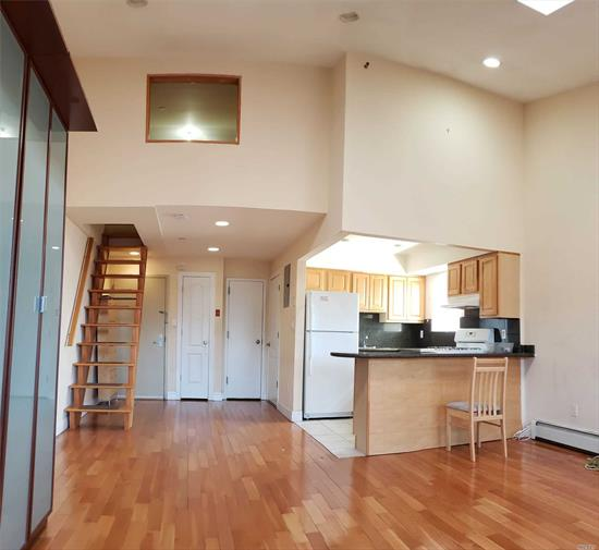 Gorgeous & Spacious 13' High Ceiling Condo Apartment In Prime Area Of Kew Gardens NY. ONE Indoor Parking Space Is not Included. indoor Parking is extra $ 250. One Added Room over Entrance Area in Unit. Eat-In-Kitchen/ Maple Cabinetry, Counter Top, Marble Bathroom, Hardwood Floor And Spacious Balcony Of Living Room For BBQ Grilling And Other Activities. 2 Skylights Make The Unit Bright & Sunny. 24 Hr Camera Security Building, Laundry In Basement. No Pet & No Smoking in Unit.