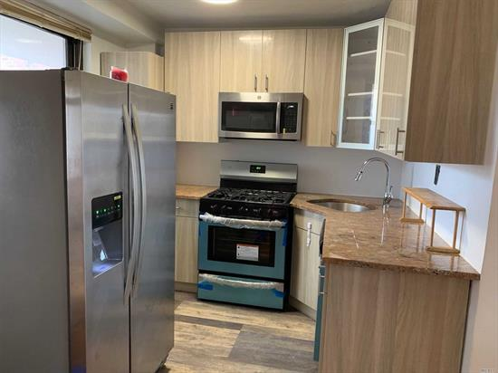 Large 1Br with separate entrance.Brand New Kitchen. Oak Flrs and Ceramic W/W on Bath. Large 32 Balcony facing front and allot of Closets. Beautiful Landscaped Rutanda. 24Hr Security Gate and 18Hrs Doorman on the bldg. New Laundry machines in Basement. Indoor garage with short wait list. Public Parking one block on Rego Center Mall and Costco store is one block. 5 mints walk to subway and express bus in front. Must come to see & grab it.