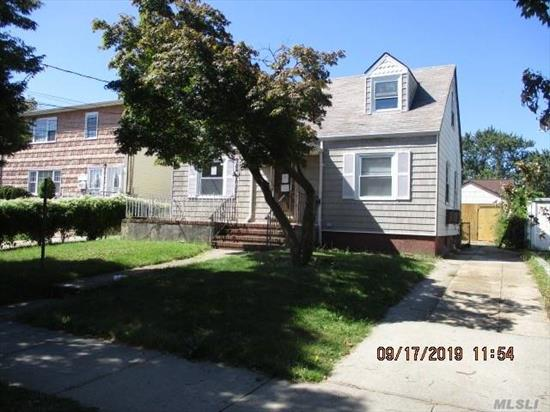Spacious detached cape , with large yard and detached garage. Quiet residential block convenient to all