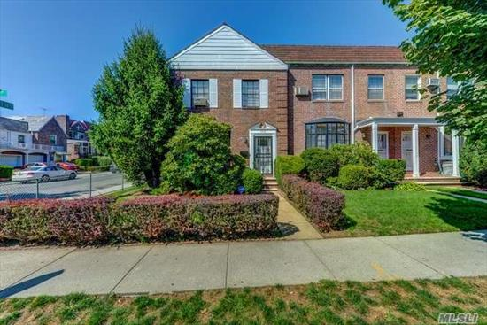 Beautiful 1 fam sd, center-hall Colonial brick townhse on corner lot. 1st fl: entry foyer w/closet, elegant sunken LR w/bay windw & tall side windws, FDR, EIK, powder rm & access to patio/backyd. 2nd fl:grand master BR w/Mbath, 2 additional BRs & hall bath w/skylight. Basement: spacious wood-paneled fam rm w/dry bar & high ceilings. Laundry & boiler rm. Pristine manicured frt yrd, side yrd & backyrd w/lawn & hedges + fenced-in patio area, 1 car det garage + parking in drivewy. Close to ALL.