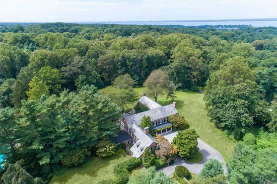 Long Field, designed by renowned architect Bradley Delahanty in 1928, is protected by 10 rolling, serene private acres. Magnificent Brick Georgian.Classic architectural details abound, gracious entertaining rooms with French doors to terraces, many fireplaces, 2 story terracotta solarium, 7 bedrooms plus staff quarters. Har Tru Tennis court, pool and large cabana.