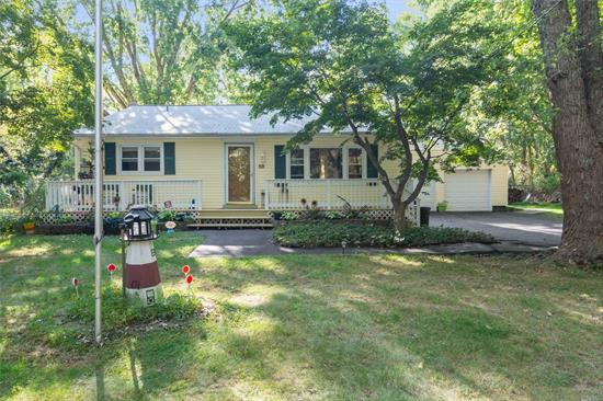 Wonderful 3 B/R 2 bath Expanded Ranch set on over 1/2 acre of Private Wooded Fenced Property. Updates include Roof, Windows, Siding and 200 Amp Service. Lots of Living Space with a beautifully manicured backyard featuring a Koi Pond.