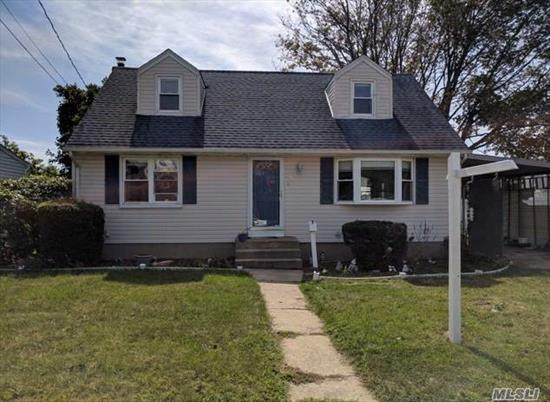 Beautiful One Family Cape With Hard Wood Floors, A Sprawling Back Yard, And A Full Basement For Storage! Close To The Beautiful And Tranquil Bethpage State Park And All Your Shopping And Dining Needs. Don't Miss This Amazing Opportunity!
