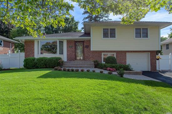 Welcome Home To Your Beautiful 3-Bedroom, 1.5 Bath Split. This Home Features An Open Floor Plan Boasting A Living Room , Full Formal Dining Room, A Beautiful Eat-In-Kitchen Featuring Updated Appliances. There Is Natural, Maintenance Free Gas Heat, Central Air Conditioning, Custom Mill Work And Lighting Throughout This Fabulous Home. Great Attention To Detail Is Prevalent Here. This Home Is Move-In-Ready! Please Hurry! This Listing Will Not Last!!!
