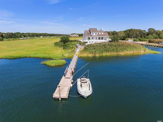 Incredibly unique opportunity to own a private island in Westhampton. 87 Baycrest is fully renovated throughout, offering an eat-in-kitchen, living room with dining area, den, and master suite on the first floor. The second level features two additional bedrooms & full bath, with views from all rooms. Additional amenities include the vast pool level cabana with full bath, gunite pool, outdoor shower, dock, & attached garage. Incredible home with nearly 360 degree views of Moriches Bay.