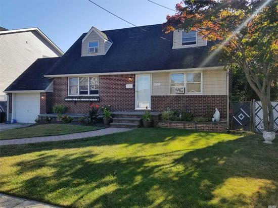 Location! Location! Location! Mid-block Cape in Massapequa School District. Totally updated in 2011 with newer hardwood floors, gas for cooking, 200 amp service. Beautiful curb appeal. SOLD AS IS.