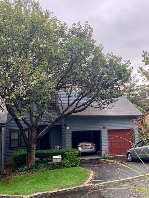 Sale may be subject to term & conditions of an offering plan. Beautifully maintained split level end unit Town home featuring large bedrooms, harwood floors, vaulted ceilings, updated bathrooms, 2 car att garage, pvt. rear deck. Located in beautiful Landmark community. Walk to shopping and dining. Please verify all info.