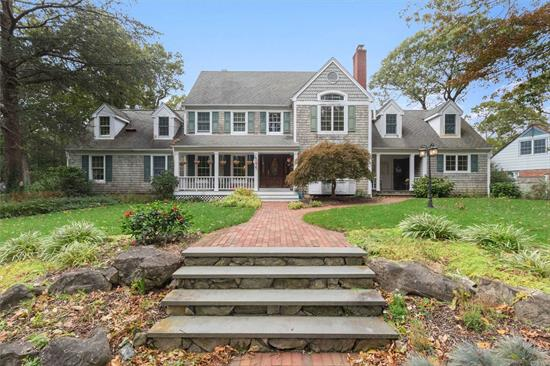 Magnificent Colonial with front porch for relaxing. Beautifully landscaped property w/in-ground pool & waterfall. Patio and decks adorn the yard including an outdoor shower & spa. Spacious rooms, CAC, IGS, Central Vac. Master suite w/ balcony overlooking huge great room w/fireplace. Too much to list! A MUST SEE CUSTOMIZED HOME!