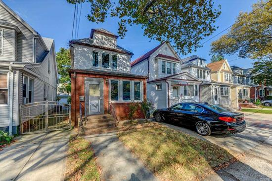 This beautiful detached colonial is located in the heart of Forest Hills. Southern exposed 1 family w/a sun-drenched LR, formal DR, spacious EIK w/a powder room & bonus room on the 1st level. Exit to a private backyard, detached garage & private driveway. 3 spacious bedrooms & a full bath is situated on the 2nd level. The basement is finished with a family room, full bath & a bar perfect for entertaining. Hardwood flrs, updated windows, 4 split AC. Bus around the corner with access trains. PS144