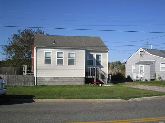 Cute 2 bedroom home with water views across from recreational park and beach.