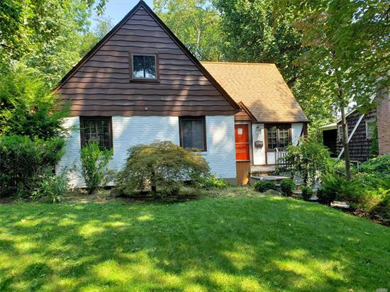 Spacious and bright Beacon Hill Tudor on large lot of 60x191. Large gourmet kitchen, first floor master suite with sunroom. Tons of charm, must see! Less than 1 mile to main street and LIRR. As-Is condition.
