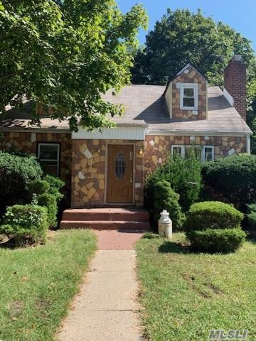 4 bedroom, 2 bathroom cape situated on a large property of 50x125 with 1 car detached garage. Conveniently located near parkways. House in need of major repairs requiring a cash purchase or rehab loan. Pipes, radiators and fixtures torn out. Being sold as-is.
