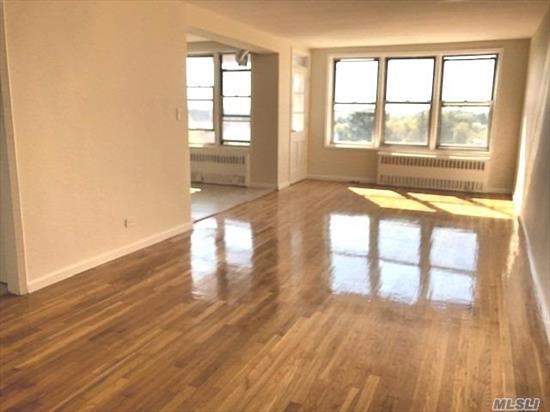 Airy and spacious corner unit w/ gleaming hardwood floors throughout. Formal dining area, eat-in kitchen w/ new appliances w/ window, access to balcony, updated bath, great sized bedrooms w/double closets, master br has full bath, lots of closets. convenient location!