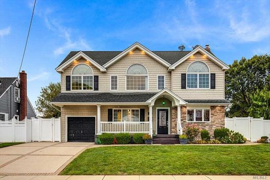 Forget About Any Other Homes you May Have Seen!!This is a MUST SEE!!Practically a Brand New House-Great for the Large Family, 10 Rooms 6 Bedrooms & 4 Full Baths-Upper Level 2nd LR/Family Rm w/Electric Fpl Cathedral Ceiling-MBR/Wic Fbth-Br-Br-Br-Fbth-ML New Fbth-Eik, New Stainless Steel Appliances Gas Cooking New Hardwood Floors-OSE & All New Fin Bsmt-Gas Furnace-Windows-Family Fun Yard New Paver Patio-Shed-South Facing Sparkling Diamond with a Front Porch